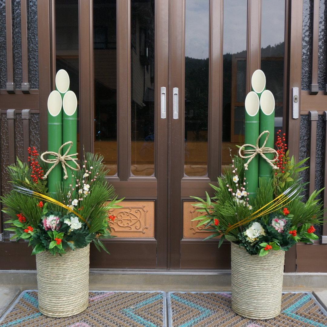 a green decoration made of pine bamboo and plum ume trees in front of japanese peoples houses and offices during the last few days of the old year